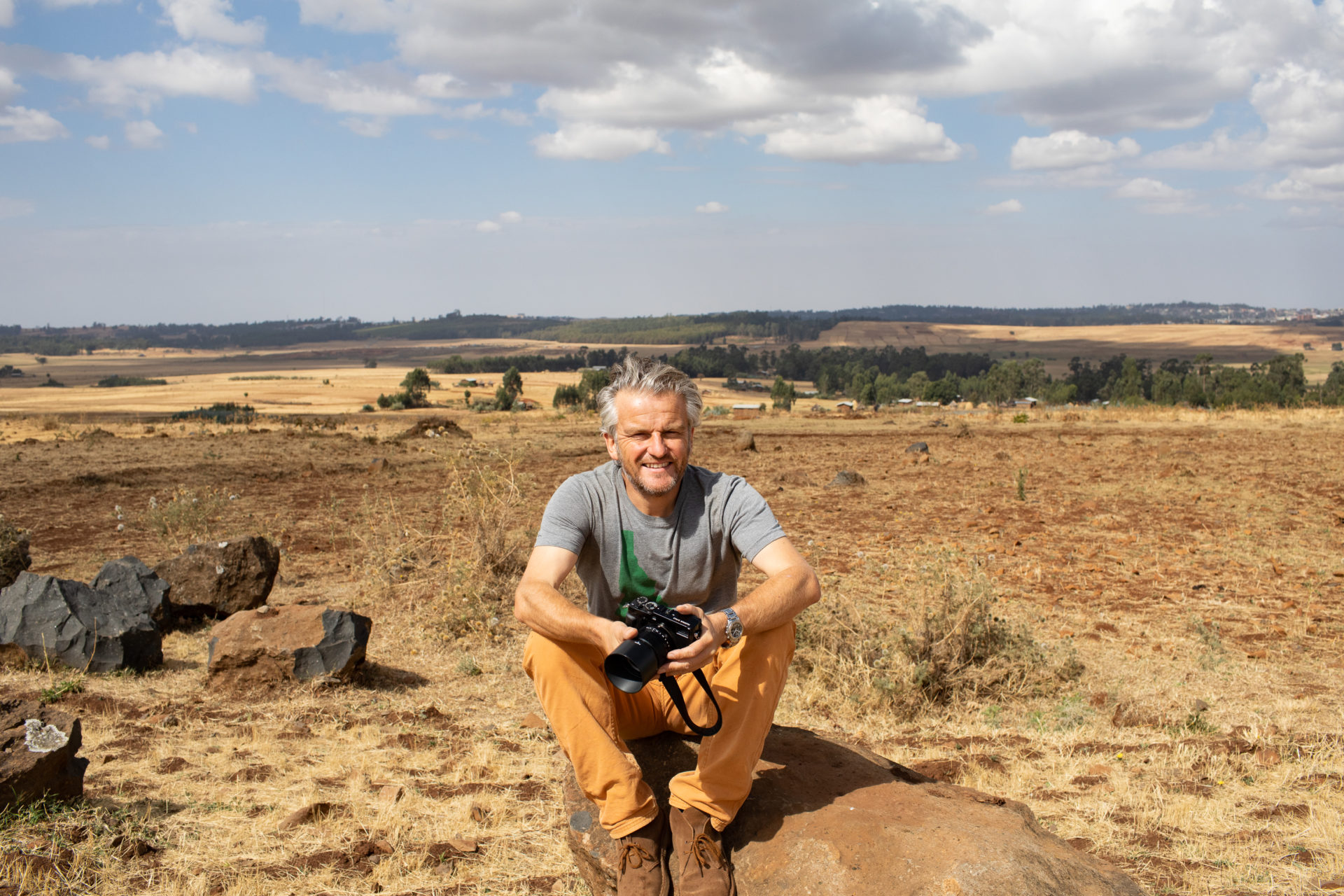 Simon Scott sitting in Africa