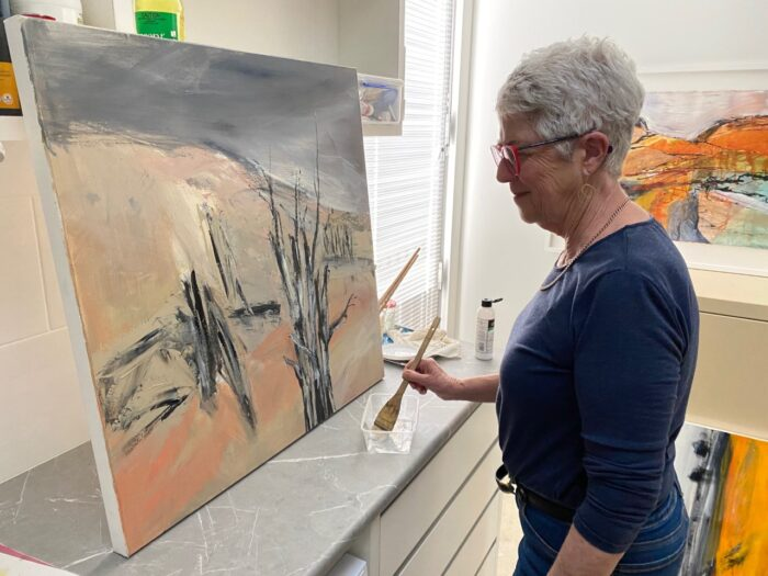 Kerry Dunne painting a landscape