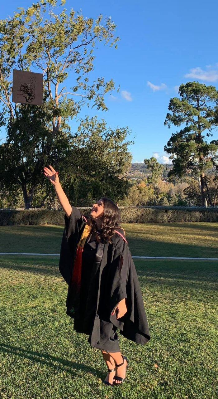 Noni Hawkins in her Graduation Gown tossing her hat into the air