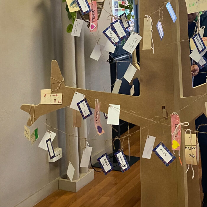 person adding a message of acknowledgement to the Sorry Tree