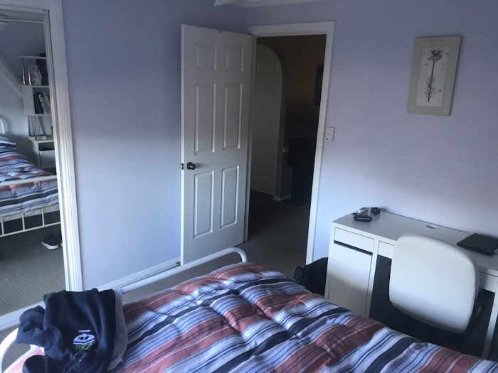 Bedroom for university student with a desk and bed