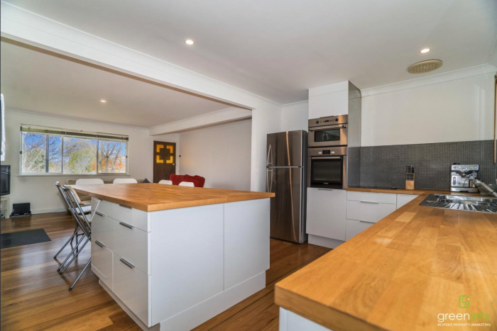 Large kitchen with island bench in share house