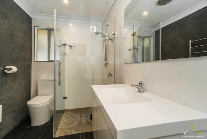 Modern bathroom with large shower in share house
