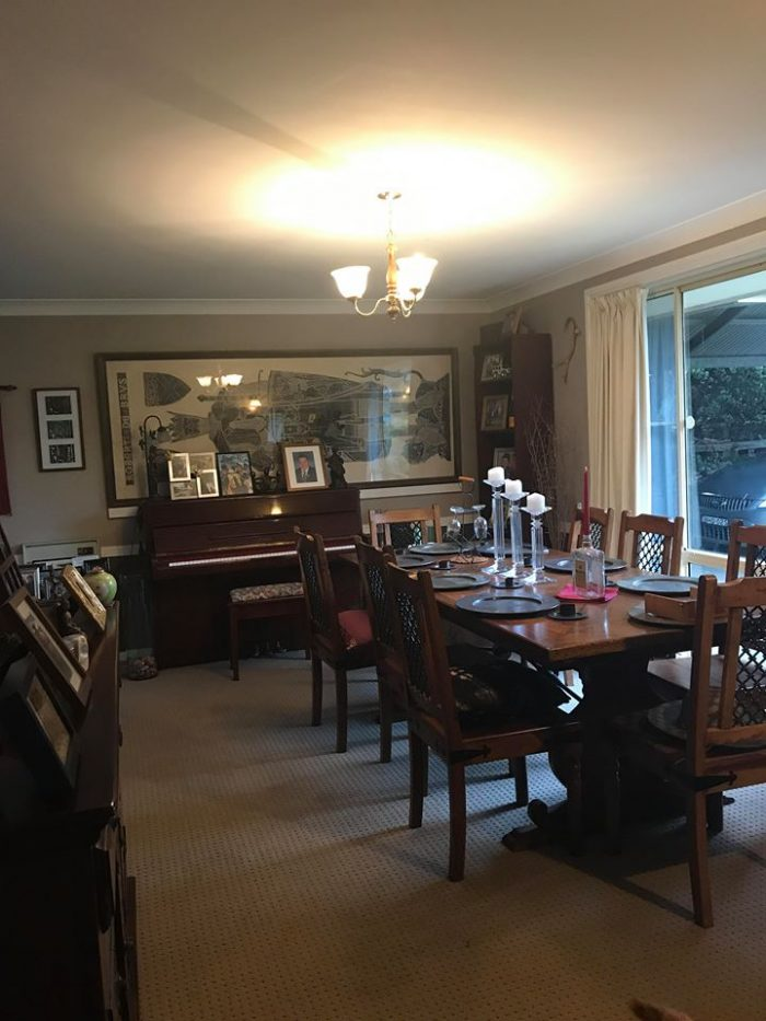 Dining room available in share house with dining table for hosting guests and a piano