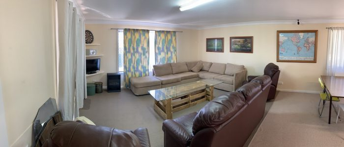 Lounge room with tv and lounges for a share house in Niagara Street