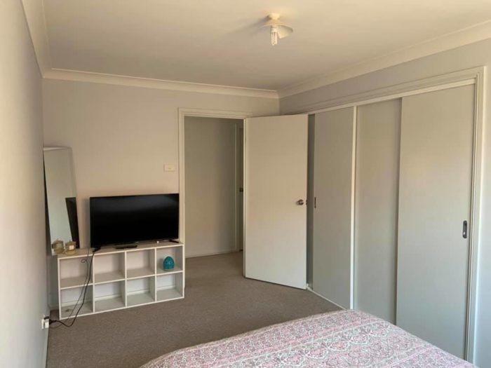 Martin Street bedroom, view of door and TV