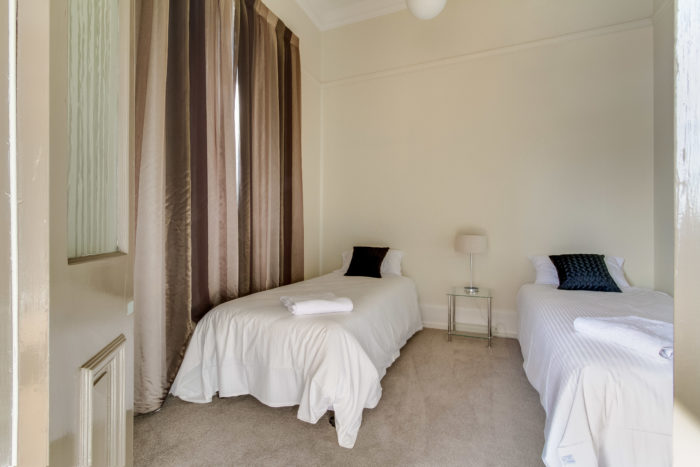 Bedroom with 2 king singles