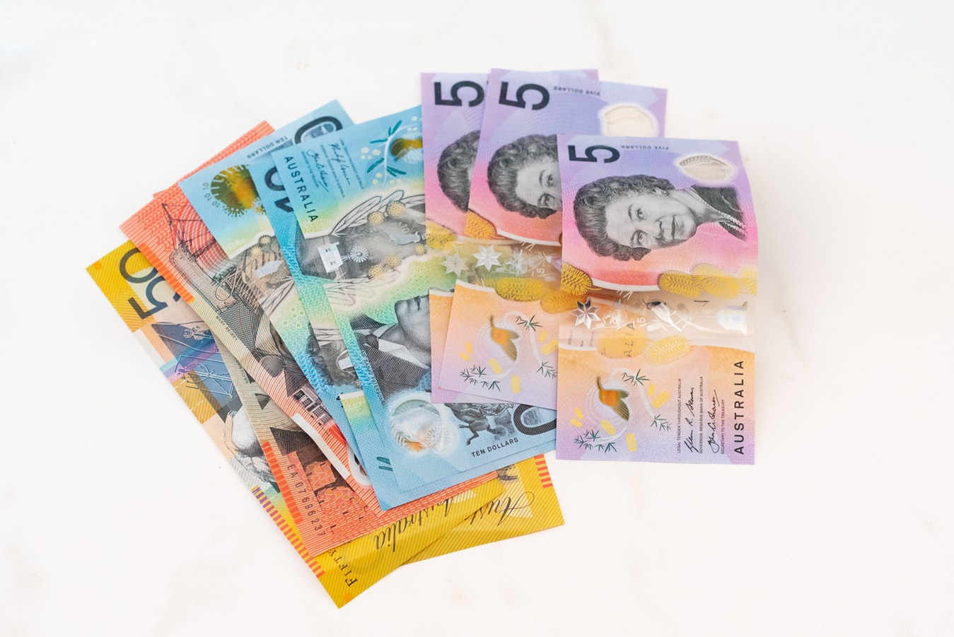 Australian bank notes on a white surface