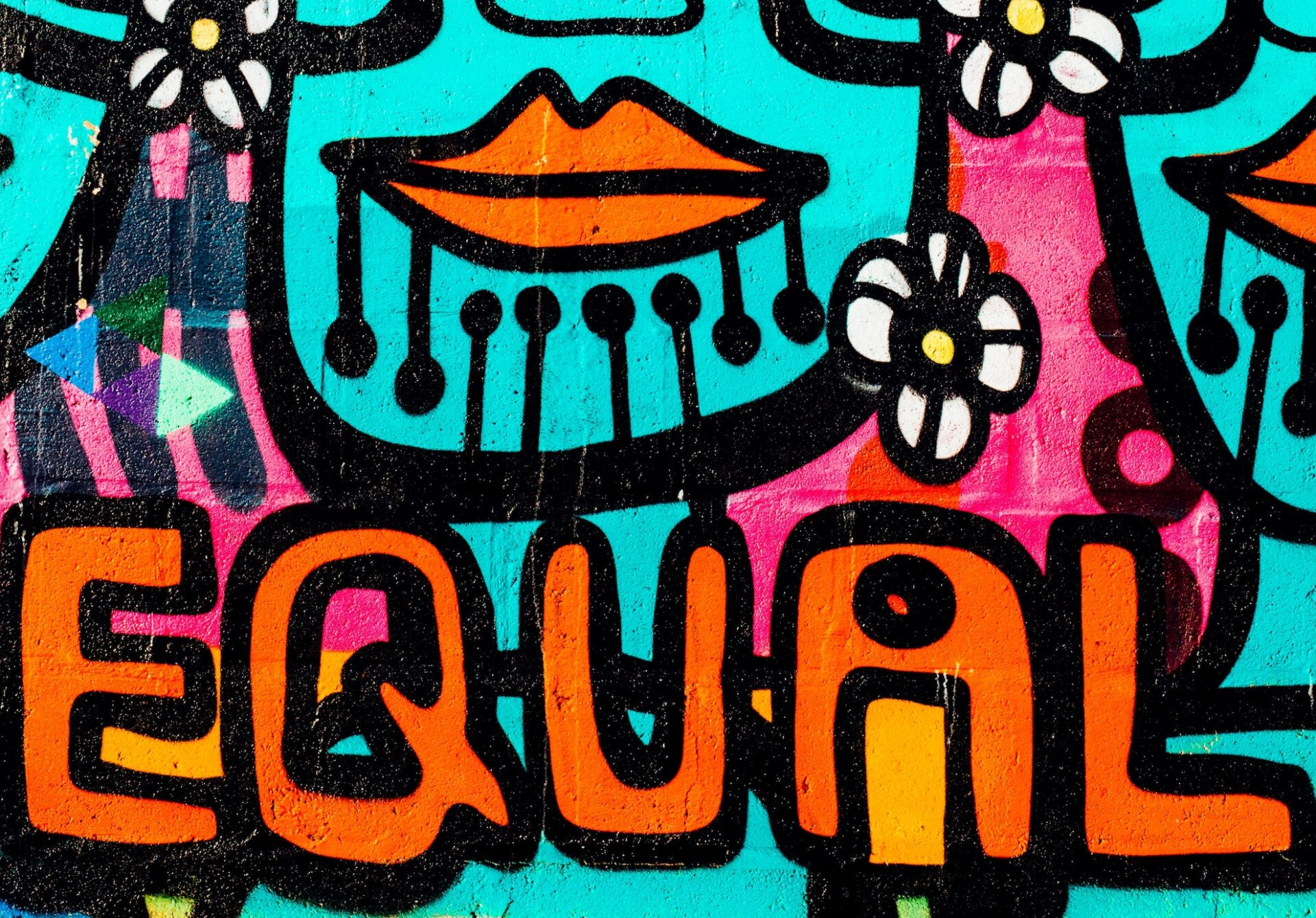 colourful mural on a brick wall with the word Equal as the focal point