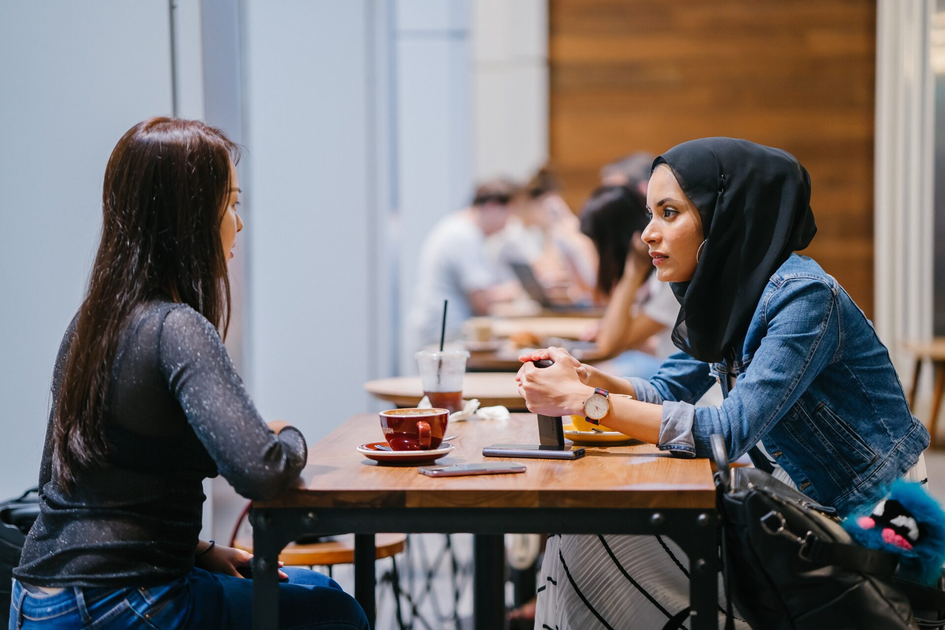 two ladies talking over coffee