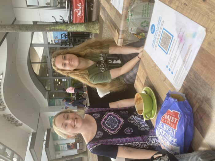 two students sitting at a cafe when meeting UNE Life Advocates in the Road