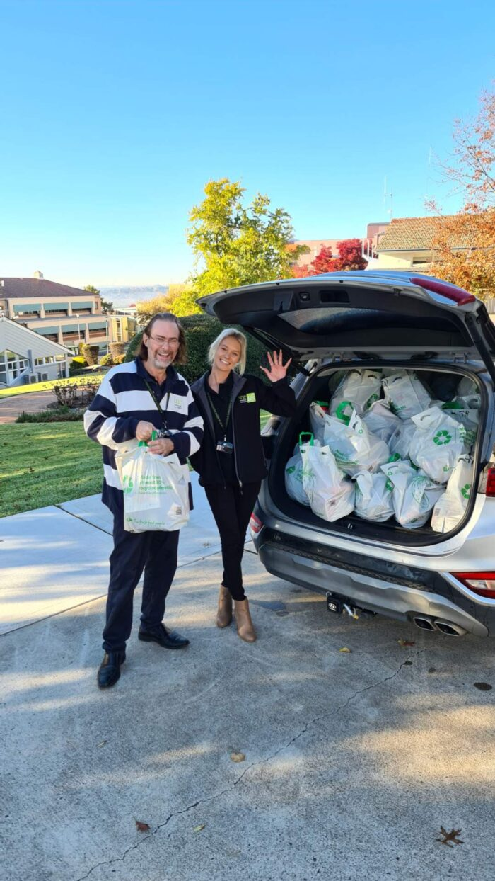 UNE Life Advocates standing in front of a car filled with groceries to deliver to students